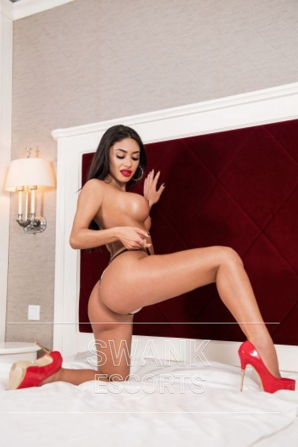 Malina showing her big round ass and long legs wearing red high heels on bed